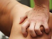 Nude boys holding their...